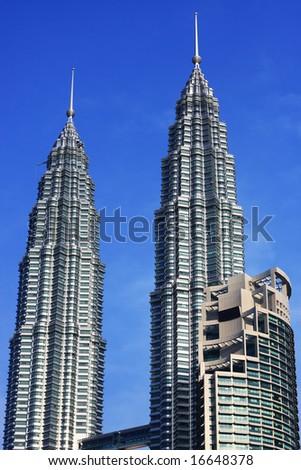 Petronas Twin Towers over blue sky in Kuala Lumpur, Malaysia. - stock photo