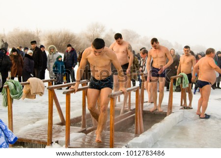 PETROPAVLOVSK, KAZAKHSTAN- JANUARY 19, 2018: The Baptism. People swim in the ice hole in winter.