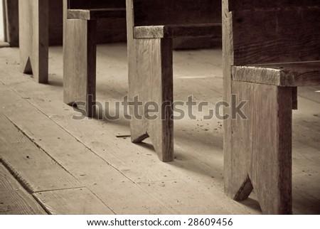 pews at an abandoned church - stock photo