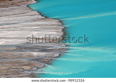 Peyto Glacier meltwater flows into Peyto Lake in Banff National Park - Canada - stock photo