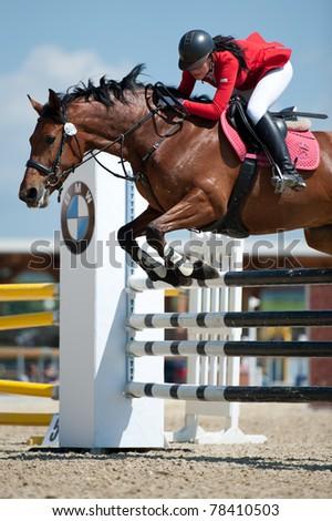 PEZINOK, SLOVAKIA - MAY 29: Gabriela Radova (CZE) on horse Venela clears a jump at Sharon Grand Prix CSI1* on May 29, 2011 in Pezinok, Slovakia - stock photo