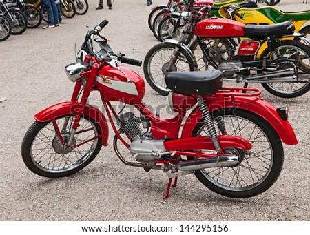 """PEZZOLO DI RUSSI, RA, ITALY - JUNE 9: old italian moped Moto Morini Corsarino 50 4t Donna exposed at the motor festival """"Festa de mutor"""" on June 9, 2013 in Pezzolo di Russi, RA, Italy - stock photo"""