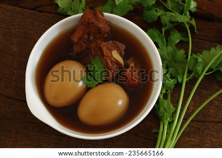 Phalo is food with eggs and pork in brown sauce.