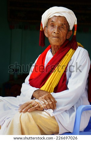 PHAN RANG, VIET NAM- OCT 22: Portrait of Vietnamese old man, senior male in tradition clothing of Cham people at Kate carnival, important festival of Cham Ba la mon, Oct 22, Vietnam, 2014