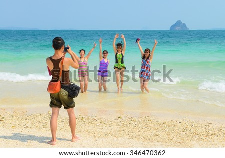 PHANG NGA,THAILAND - MARCH 24 :  Tourists are shooting pictures, having fun on the beach in summer at Khai Nok island. - 24 March 2015, Phang Nga, Thailand