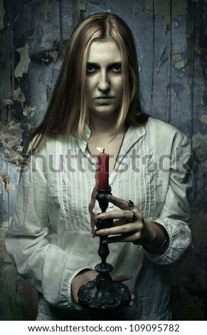 phantom girl with candle - stock photo