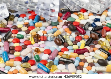 Pharmaceutical background of colorful pills and drugs - stock photo