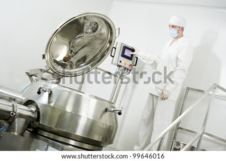 pharmaceutical factory worker at pharmacy industry manufacture with granulator