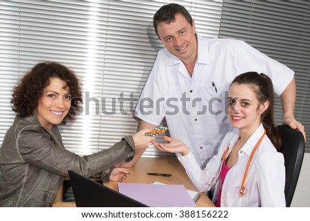 Pharmaceutical Sales Representative with two doctors at clinic