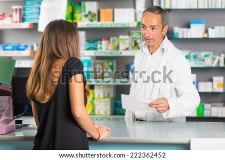 Pharmacist and Client in a Drugstore - stock photo