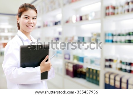 pharmacist chemist and medical doctor woman asia with stethoscope and clipboard checking medicine cabinet and pharmacy drugstore  - stock photo