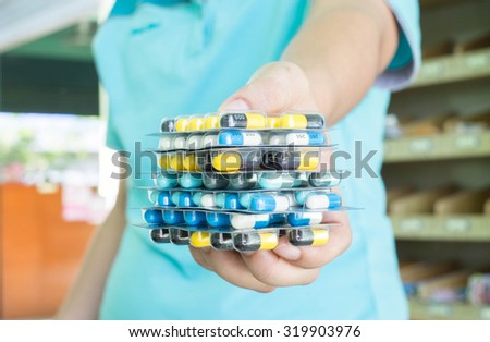 Pharmacist holding Tablets pills capsules