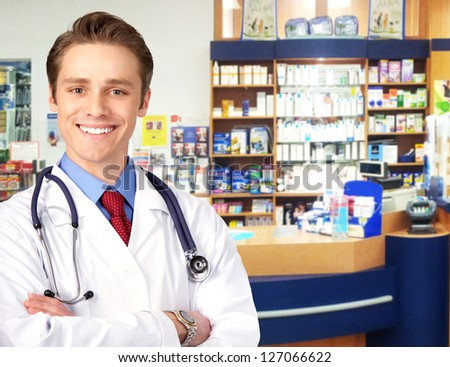 Pharmacist in a drugstore. Health care concept - stock photo