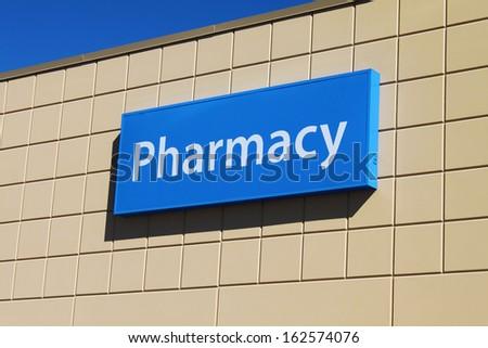 Pharmacy sign on a building facade - stock photo