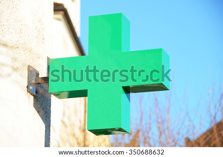 Pharmacy sign on the wall - stock photo