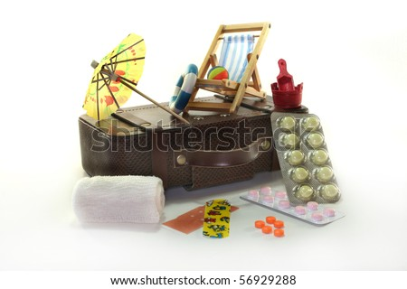 Pharmacy travel with suitcases and drugs against a white background - stock photo