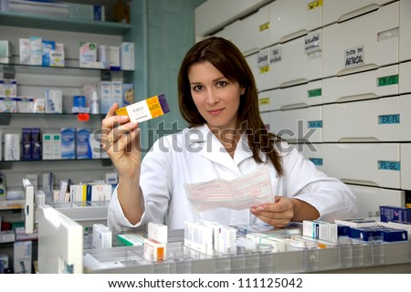 Pharmacy woman working with medicine and prescription - stock photo