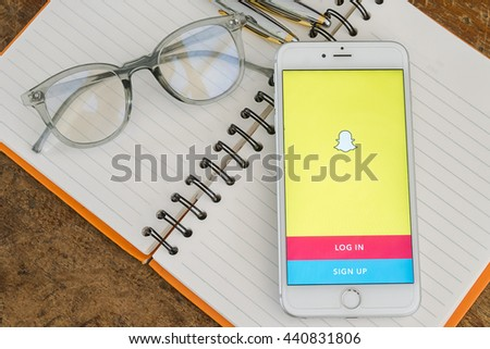 PHAYAO, THAILAND - JUNE 22, 2016: White Apple iPhone 6s Plus open Snapchat application, Snapchat Released in September 2011, Snapchat is popular a photo messaging application - stock photo