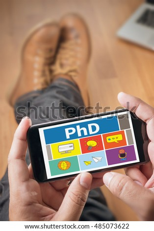 PhD Doctor of Philosophy Degree Education Graduation Thoughtful male person looking to the digital phone screen,Silhouette top computer and hand