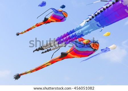 PHETCHABURI, THAILAND - MARCH 29: monster tadpoles kite with blue sky background at Cha-Am International Kite festival March 29, 2015 at Phetchaburi, Thailand.