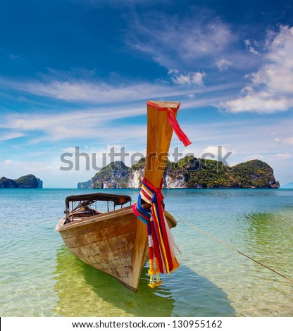 Phi Phi Island - Traditional longtail boat in Loh Dalum Bay, Thailand - stock photo