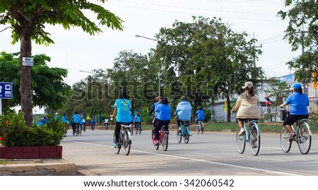 PHICHIT THAILAND-AUGUST 19: Bike for mom from the back of the person wearing the blue shirt  who was riding a bicycle on the road.On August 19, 2015 in  Phichit, Thailand. - stock photo