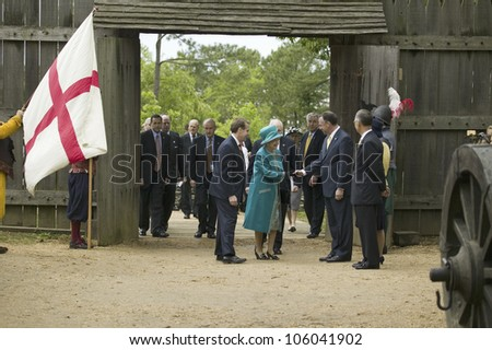 Phil Emerson (left) and Her Majesty Queen Elizabeth II shaking hand of Governor Timothy Kaine during her official visit James Fort, Jamestown Settlement, Virginia on May 4, 2007. - stock photo