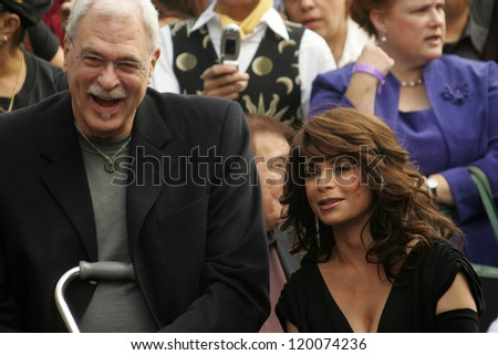 Phil Jackson and Paula Abdul at the Ceremony Honoring Los Angeles Lakers Owner Jerry Buss with the 2,323rd star on the Hollywood Walk of Fame. Hollywood Boulevard, Hollywood, CA. 10-30-06 - stock photo