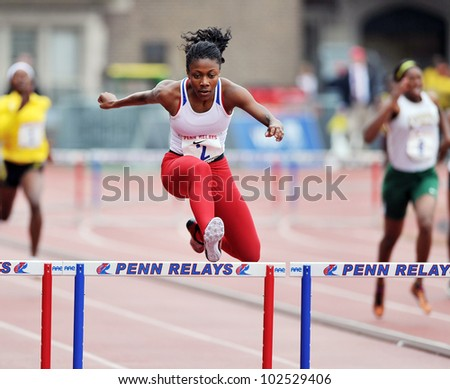 PHILADELPHIA - APRIL 26: Alexis Franklin competes in the girls 400 meter high school championships at the Penn Relays April 26, 2012 in Philadelphia. - stock photo