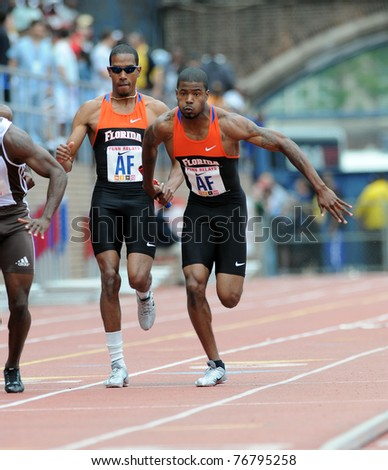 PHILADELPHIA - APRIL 29: Christian Taylor (l) passes the baton to Terrell Wilks during a heat at the 117th Penn Relays on April 29, 2011 in Philadelphia, PA
