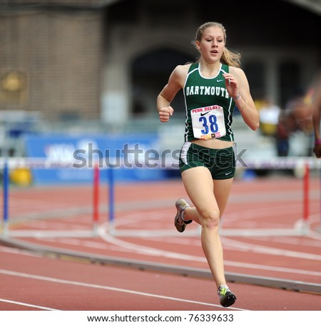 PHILADELPHIA - APRIL 28: Dartmouth University's Megan Krumpoch heads down a straight in the women's 400 meter Hurdles Championship at the 2011 Penn Relays on  April 28, 2011 in Philadelphia, PA - stock photo