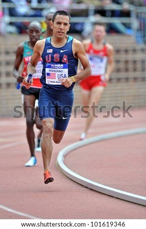 PHILADELPHIA - APRIL 28: Leo Manzano from the USA runs the anchor leg of the USA vs the World distance Medley at the Penn Relays April 28, 2012 in Philadelphia. - stock photo
