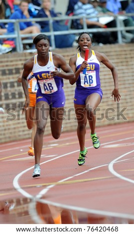 PHILADELPHIA - APRIL 28: Rebecca Alexander (with baton) of LSU shouts to her teammate just prior to the final hand-off in a 4x100 heat at the 117th Penn Relays on April 28, 2011 in Philadelphia, PA