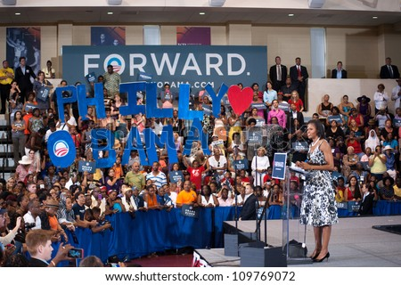 PHILADELPHIA - AUGUST 9: First Lady Michelle Obama urges supporters to spread the word and gain at least one new voter to help the outcome of a very close election on August 9, 2012 in Philadelphia. - stock photo