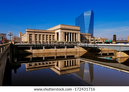 PHILADELPHIA - DEC 1: The 30th Street Station is reflected in the still waters of The Scullykill River, as seen from the Norman Cohn Family, Market Street Bridge on Dec 1, 2013 in Philadelphia, USA - stock photo