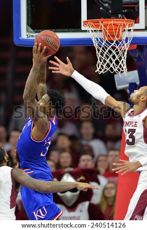 PHILADELPHIA - DECEMBER 22: Kansas forward Jamari Traylor (31) grabs a rebound away from Temple Owls center Devontae Watson (23) during the NCAA basketball game December 22, 2014 in Philadelphia.