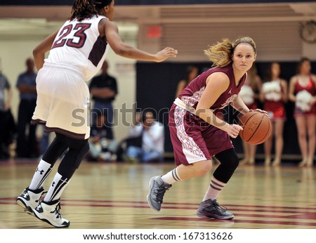 PHILADELPHIA - DECEMBER 4: St. Joseph's (PA) Hawks guard Erin Shields (3) looks for room to pass or drive in a Big 5 basketball game December 4, 2013 in Philadelphia.  - stock photo
