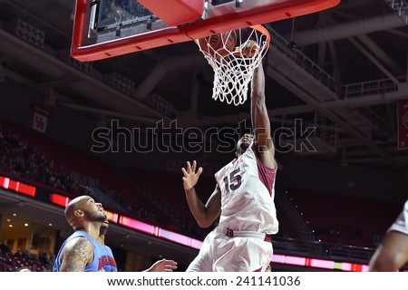 PHILADELPHIA - DECEMBER 28: Temple Owls forward Jaylen Bond (15) throws down a dunk during the NCAA basketball game December 28, 2014 in Philadelphia.  - stock photo