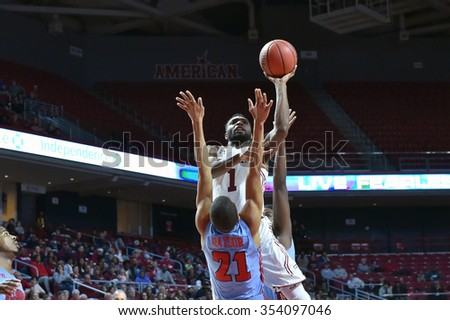 PHILADELPHIA - DECEMBER 19: Temple Owls guard Josh Brown (1) goes up for a shot during the basketball game December 19, 2015 in Philadelphia.  - stock photo