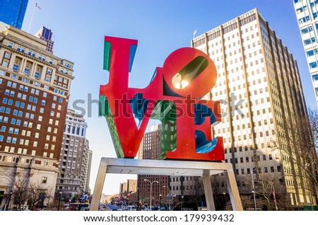 PHILADELPHIA -  FEB 2014: The Love statue on February 27, 2014. The Love Park named after the Love statue in Philadelphia. It was first placed in the plaza in 1976 and has since become a global icon - stock photo