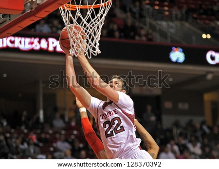 PHILADELPHIA - FEBRUARY 14: Temple Owls forward Jake O'Brien (22) goes up for a shot during an Atlantic 10 conference basketball game February 14, 2013 in Philadelphia