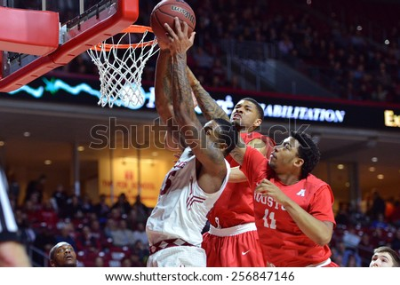 PHILADELPHIA - FEBRUARY 26: Temple Owls forward Jaylen Bond (15) fights off Houston guard LeRon Barnes (4) for a rebound during the AAC college basketball game  February 26, 2015 in Philadelphia.  - stock photo