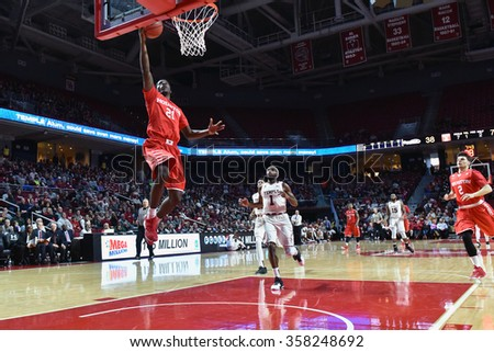 PHILADELPHIA - JANUARY 2: Houston Cougars guard Damyean Dotson (21) takes off for a aly-up during the American Athletic Conference basketball game January 2, 2016 in Philadelphia.  - stock photo