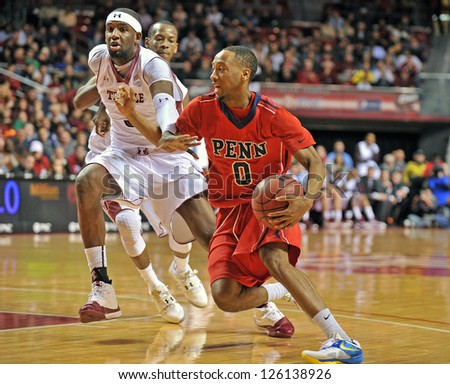 PHILADELPHIA - JANUARY 23 :Penn guard Miles Cartwright (0) drives to the basket during the 'Big 5' basketball game against Temple January 23, 2013 in Philadelphia.