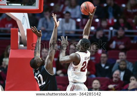 PHILADELPHIA - JANUARY 16:Temple Owls center Ernest Aflakpui (24) shoots over a defender during the American Athletic Conference basketball game January 16, 2016 in Philadelphia.  - stock photo
