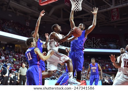 PHILADELPHIA - JANUARY 14: Temple Owls guard Devin Coleman (34) appears to hang in the air taking a shot during the AAC conference college basketball game January 14, 2015 in Philadelphia.  - stock photo