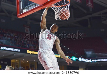 PHILADELPHIA - JANUARY 4: Temple Owls guard Will Cummings (2) finishes a slam dunk in the American Athletic Conference basketball game January 4, 2015 in Philadelphia.  - stock photo