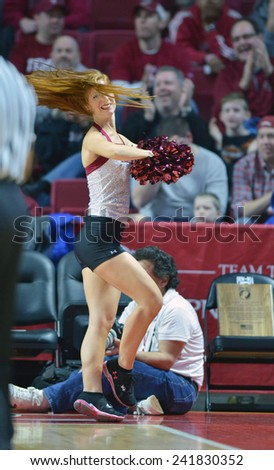 PHILADELPHIA - JANUARY 4: The Temple Diamond Gems dance team performs during the American Athletic Conference basketball game January 4, 2015 in Philadelphia.  - stock photo