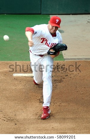 PHILADELPHIA - JULY 28: Philadelphia  Phillies ace starting pitcher Roy Halladay throws a warm up pitch in the bullpen July 28, 2010 in Philadelphia. - stock photo