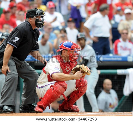 PHILADELPHIA - JULY 26: Phillies catcher Paul Bako behind the plate receiving a pitch during the July 26, 2009 in Philadelphia. - stock photo